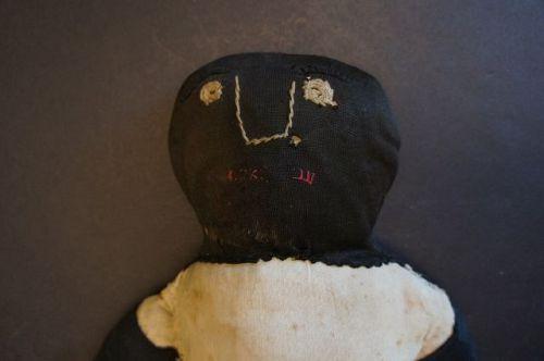 Very graphic simplistic black cloth doll heavy rag stuffed folky