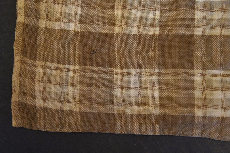 "15"" by 17"" brown cotton doll coverlet with tied quilting"