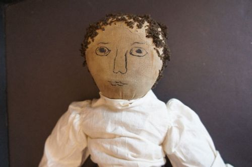 """20"""" cloth doll with a boldly drawn ink face, early yarn hair C1880"""