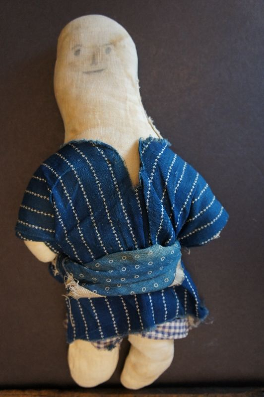 An unassuming little pencil face cloth doll 11""