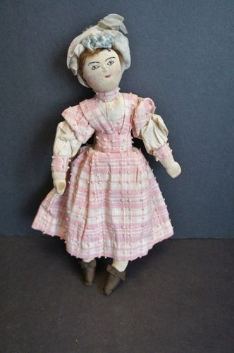 "A perfect little 11"" stockinette cloth doll with all original clothes"