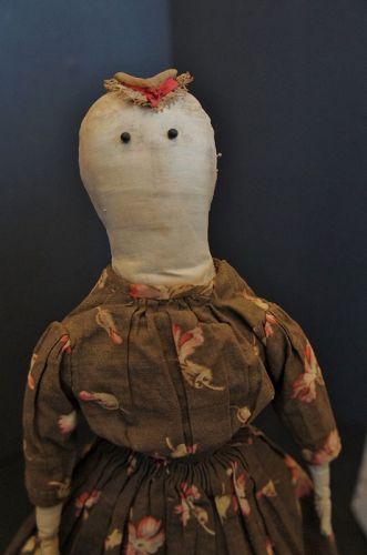 """Petite  15"""" pencil face doll wearing a brown calico dress C. 1880"""