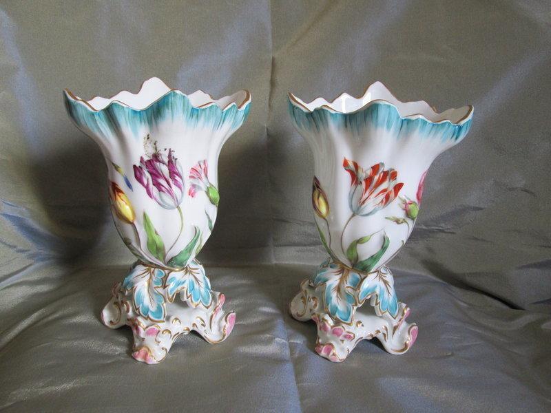 A pair of low floral decorated Coalport porcelain vases