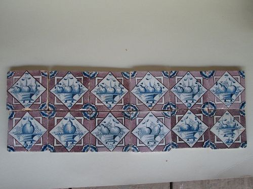 Set of 12 delft tiles of fruit basket with manganese ground c. 1750