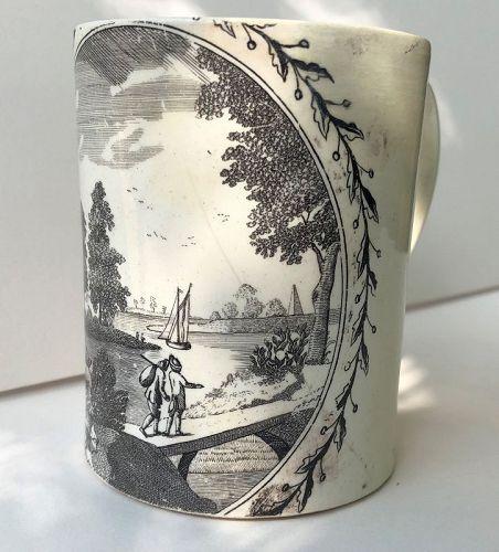 Creamware mug, black transfer peaceful river scene, English c. 1800