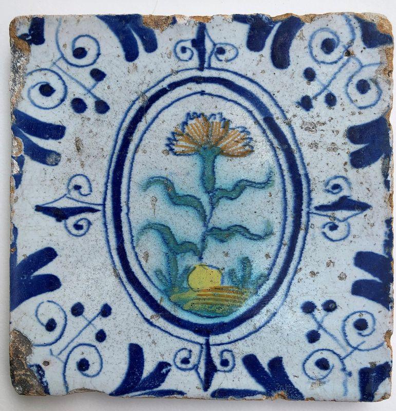 Dutch delft polychrome tile of a carnation 1st half 17th century