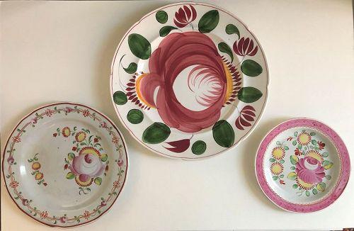 Three Staffordshire rose plates. 1st half 19th century