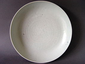 A rare,large Ming white glazed dish with incised decor