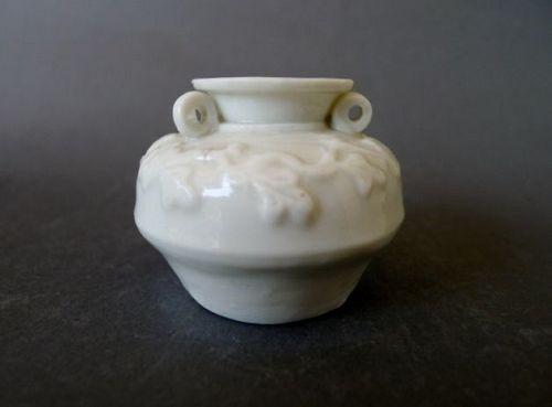 A Yuan/Ming Dynasty moulded Dehua ware jarlet