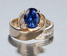 2 CARAT OVAL TANZANITE & DIAMOND RING