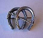 ANTIQUE STERLING DOUBLE HORSESHOE PIN WITH RIDING CROP