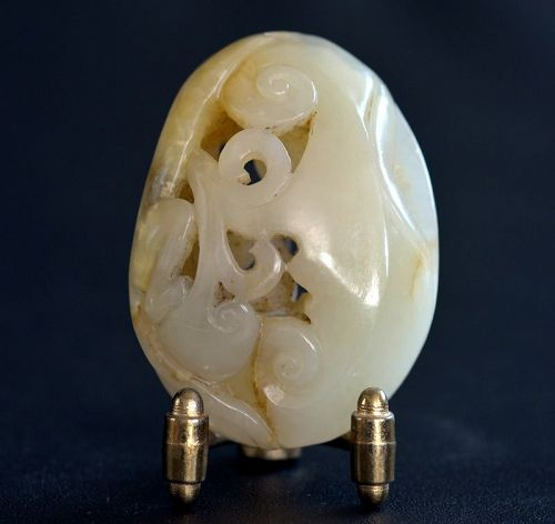 Jade Pendant Carved from a Nephrite Pebble Decorated with a Monkey