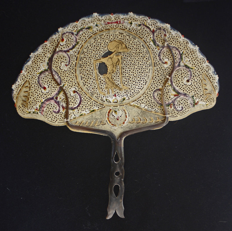 Traditional Indonesian ornate fan of hide and horn
