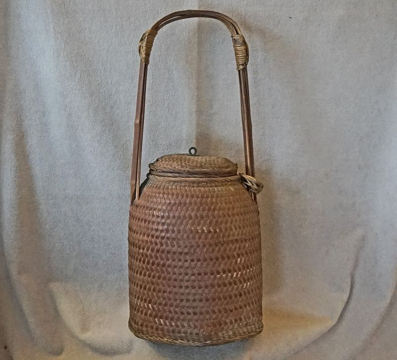 Antique Chinese tall narrow woven food storage basket