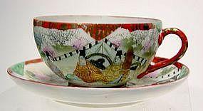 Japanese kutani porcelain cup and saucer