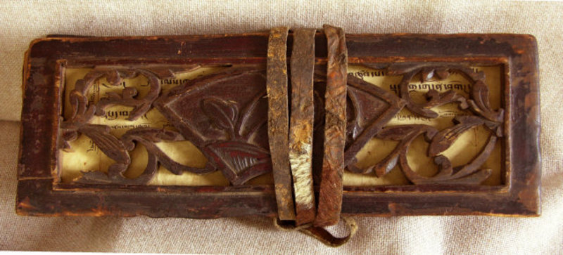 Antique Tibetan Buddhist Sutra w carved wooden covers