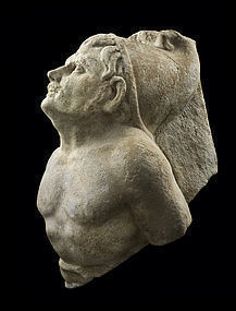 AN ANCIENT ROMAN MARBLE FIGURE OF A CAPTIVE