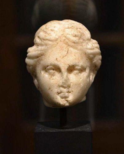 A GRECO-ROMAN MARBLE HEAD OF APHRODITE