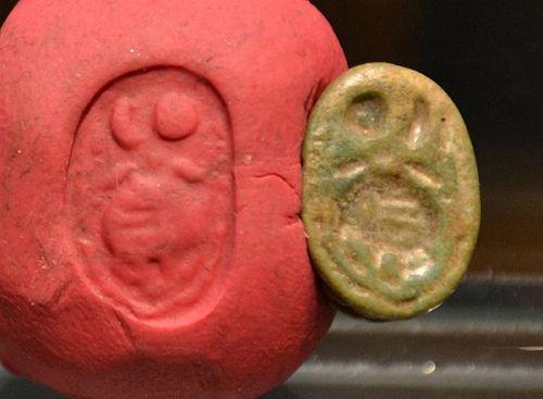 AN ANCIENT EGYPTIAN FAIENCE SCARAB