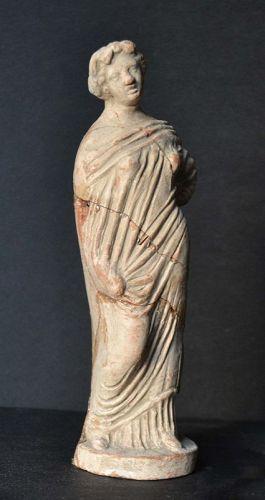 AN ANCIENT GREEK TERRACOTTA FEMALE FIGURE