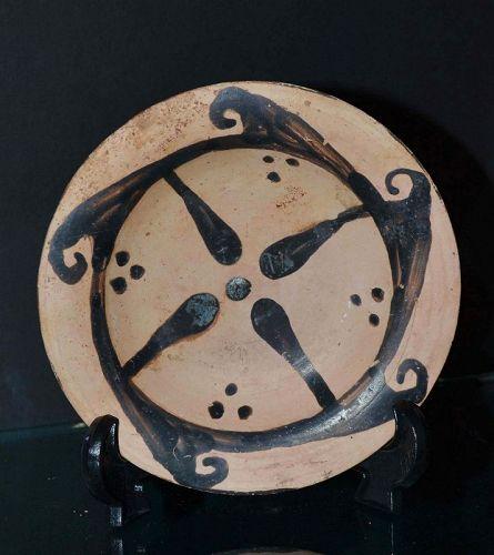 AN ETRUSCAN TERRACOTTA STAR DISH, 4th CENTURY B.C.