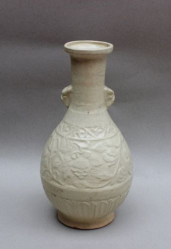 A YUAN DYNASTY FUJIAN YINGQING VASE WITH MOLDED FLOWER PATTERN