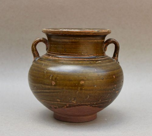 A TANG-FIVE DYNASTY BROWN GLAZED JAR WITH HANDLES