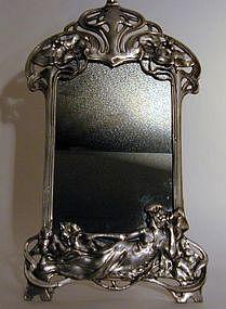A Figural Mirror
