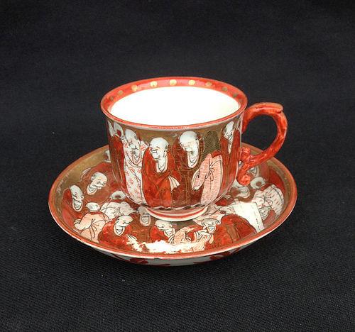 Japanese Kutani aka-e cup and saucer, Meiji