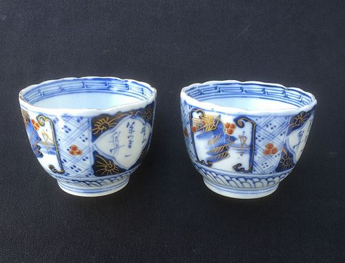 Pair of Japanese Edo Imari cups with calligraphy