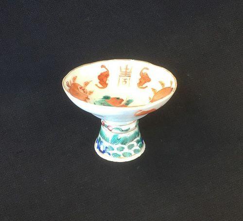 Stem cup with a goldfish, auspicious fruit, bats and Shou