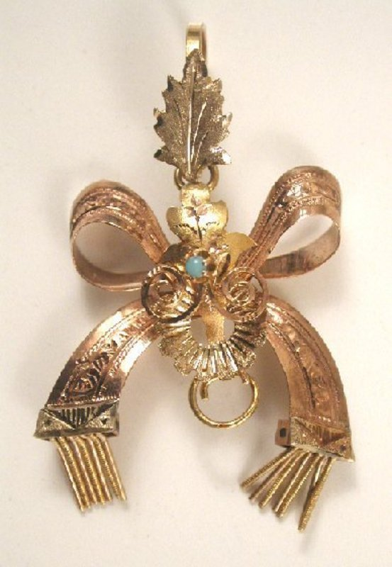 Charming Articulated Victorian Pendant, Bow