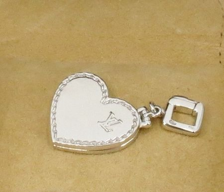 Louis Vuitton heart locket pendant in 18k white gold with box