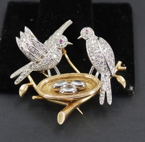Antique diamond two bird brooch in platinum and 18k gold