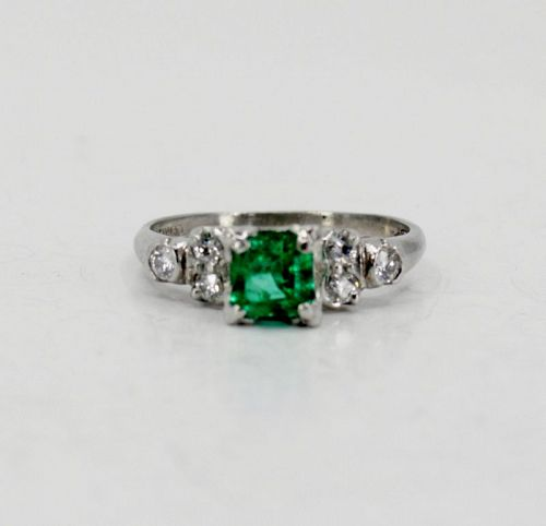 Antique, emerald, diamond engagement ring in platinum