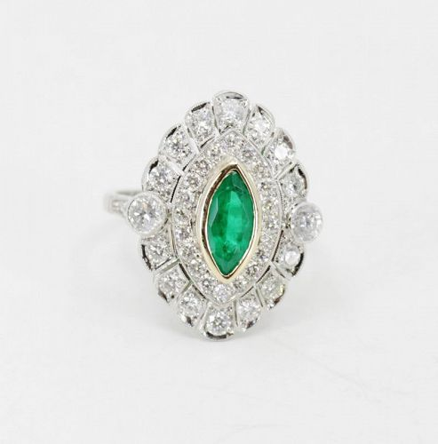 Diamond emerald engagement ring in platinum and 18k gold