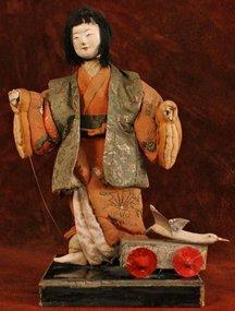 Edo Period Isho Ningyo Pulling a Wagon with a Crane