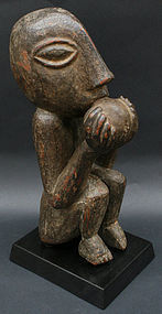 Nepalese Temple Sculpture of a Monkey Eating a Mango