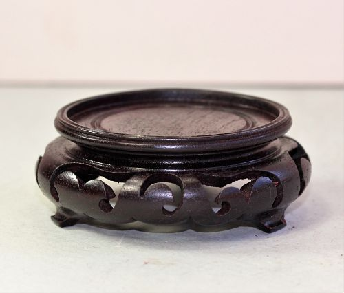 "Chinese carved Hardwood round brown display Stand, ""Hong Kong"" labeled"