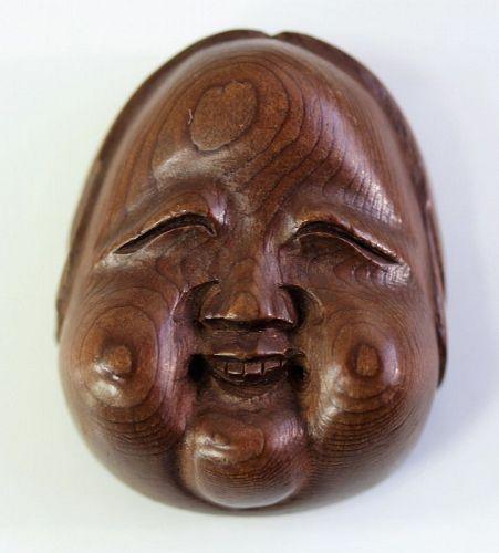 Japanese carved Wood No Mask Okame Netsuke,  Meiji period