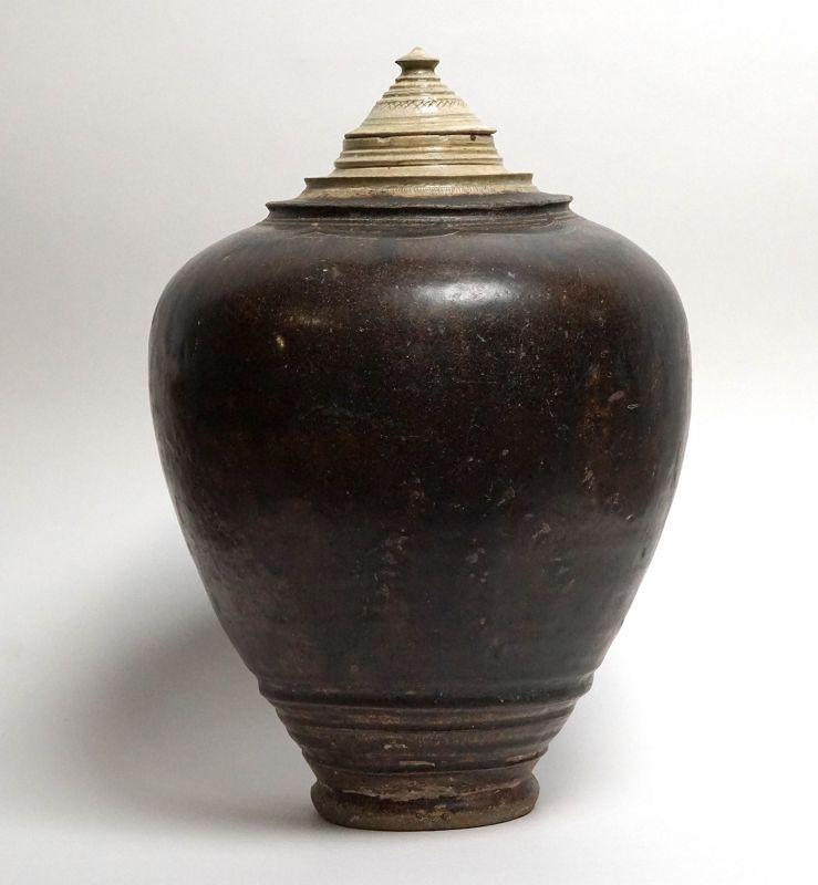 A Rare Khmer Large Bi-coloured Glazed Stoneware Jar, 12th Century