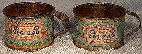 Pair ZIG ZAG CONFECTION TIN LITHOGRAPH PREMIUM MINIATURE CUPS 1900