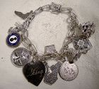 Oval Fold Over Link Sterling Silver Charm Bracelet with 12 Charms 1970