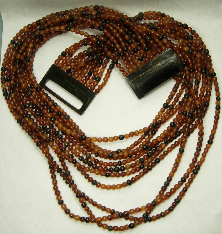 1980s Monies Carved Horn Bead 11 Strand Huge Necklace