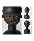Well carved helmet mask of the Bamileke People Cameroon 1950