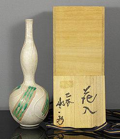 A Kutani porcelain vase by Matsumoto Saichi V.