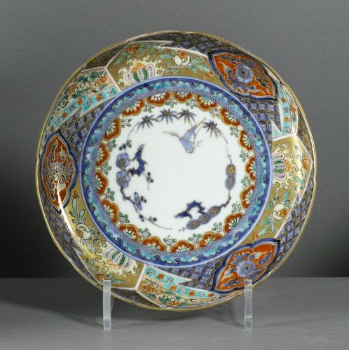 An Imari dish decorated with the Three Friends of Winter, 18/19th C.