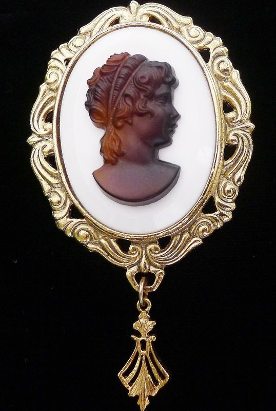 Brooch with Dark Cameo on White Glass