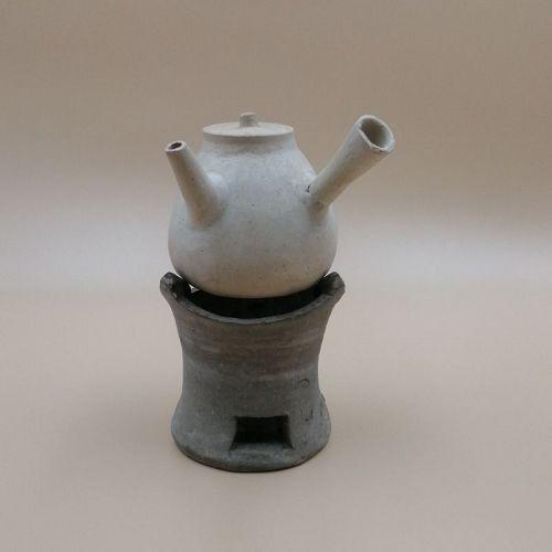 A Beautiful Set of Tea Pot and Stove.