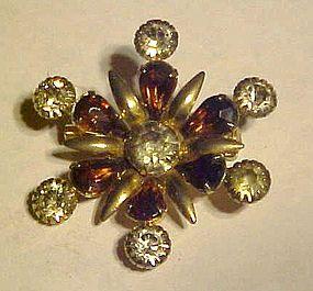 Vintage snowflake style rhinestone pin with purple